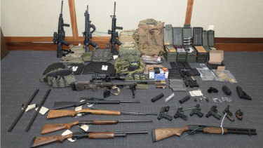 This image provided by the US District Court in Maryland shows a photo of firearms and ammunition that was in the motion for detention pending trial in the case against Christopher Paul Hasson.