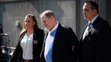 Harvey Weinstein being escorted in handcuffs out of the New York Police Department.