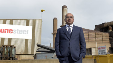 Sanjeev Gupta standing outside one of the OneSteel mills he bought in 2017.