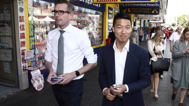Scott Yung, right, and NSW Treasurer Dominic Perrottet campaigning in Hurstville during the state election.