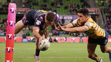 Ryan Papenhuyzen of the Melbourne Storm dives to score at AAMI Park.