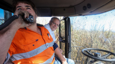 Prime Minister Scott Morrison in a cane harvester with operator Anthony Corica during a visit to a Burdekin sugar cane farm in Giru.