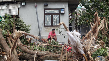 Debris sits piled up against a house at the front beach after Typhoon Mangkhut in the Shek O area of Hong Kong, China.
