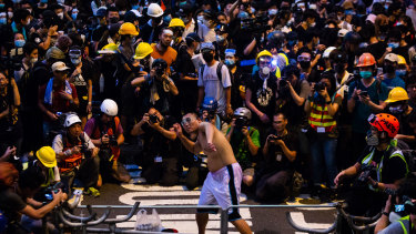 A protester throws an egg at police headquarters during a demonstrations in Hong Kong, China.