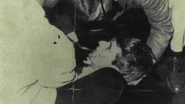 Robert F. Kennedy lies wounded on the floor of the Ambassador Hotel in Los Angeles on June 5, 1968.