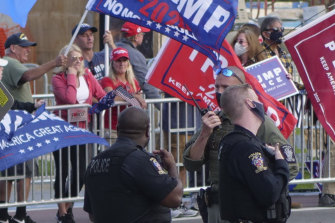 Trump supporters gather outside Walter Reed National Military Medical Centre in Bethesda, Maryland, on Sunday.
