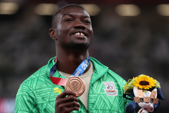 Hugues Fabrice Zango celebrates with his medal.