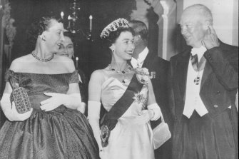 The Queen with president Dwight Eisenhower and Mamie Eisenhower at the British embassy in 1957.