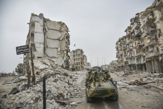 A Russian army vehicle drives through Aleppo, Syria, in 2019.