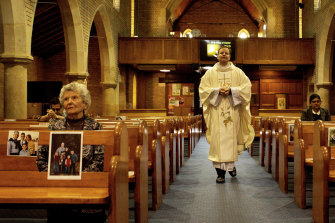 Fr Greg Morgan during a live service of up to 10 people only at St Charles church in Ryde.