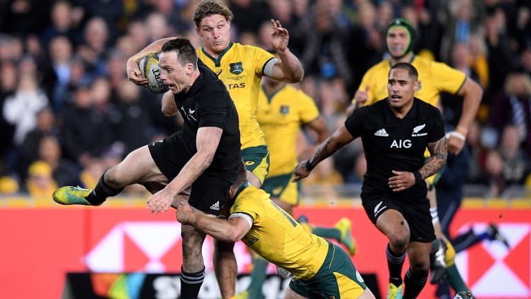 Free range: Ben Smith makes a half break in Bledisloe I in Sydney. The fullback made the break that set up New Zealand's first try just before half-time, in a classic case of striking with maximum psychological impact.