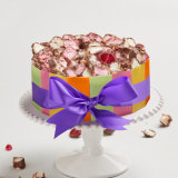 A Michel's cake featuring coloured tiles that had its expiry date extended.