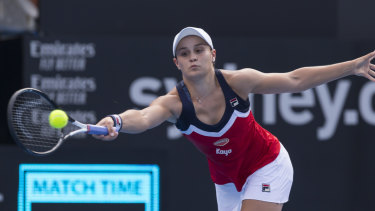 Bridesmaid again: Ash Barty stretches for a forehand in a tense Sydney International final.