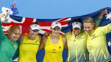 Daria Gavrilova, Stosur, Barty, Priscilla Hon and Alicia Molik celebrate Australia's win.