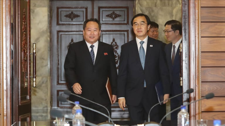 Cho Myoung-gyon, South Korea's unification minister, right, and Ri Son Gwon, chairman of North Korea's Committee for the Peaceful Reunification of the Fatherland, during a meeting in the Demilitarised Zone (DMZ) in Paju, South Korea, on Monday.