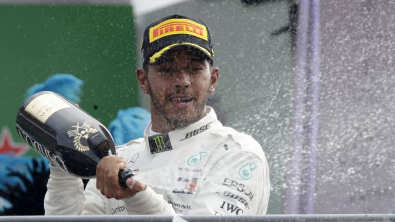 Lewis Hamilton celebrates extending his championship lead at Monza on Sunday.