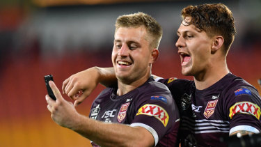 Laughing:  Cameron Munster takes a happy snap with Kalyn Ponga after Origin I.