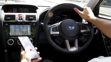 Using a mobile phone while driving attracts a $400 fine in Queensland and three demerit points.