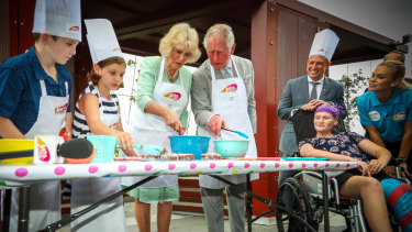 Prince Charles and Camilla make lamingtons at Lady Cilento Children's Hospital.