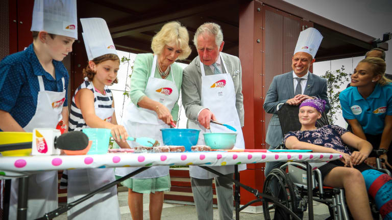 Prince Charles and Camilla make lamingtons at Lady Cilento Children's Hospital.