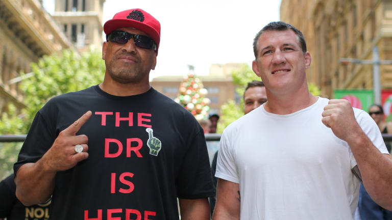 Sluggers: Former NRL player John Hopoate and Sharks captain Paul Gallen pose for photographs at Martin Place after announcing the pair will face off in the boxing ring.