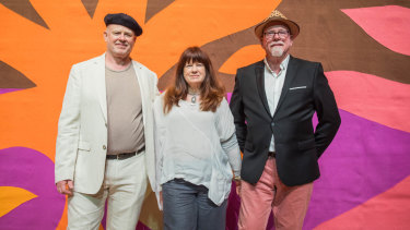 From left: DanielCoburn, KristinCoburnand StephenCoburn in front of their father John Coburn's Curtain of the Sun created for the Sydney Opera House.