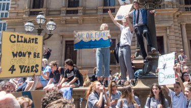 School children striking from school and protesting in the streets of Melbourne for the Government to take action on Climate Change.
