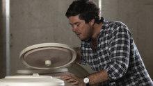 Damon Koerner checking a ceramic egg photo.