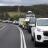 'Five kilometres in two hours': Stuck in the convoy racing to cross the Victoria-NSW border
