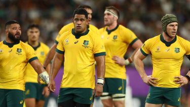 Wallabies players react to their World Cup quarter-final loss to England.