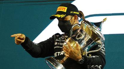 Hamilton holds off Verstappen to win tense season opener in Bahrain