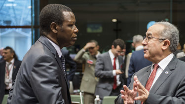 African Union Commissioner for Peace and Security Ramtane Lamamra, right, talks with United Nations High Representative for Mali Pierre Buyoya during a ministerial meeting in 2013.