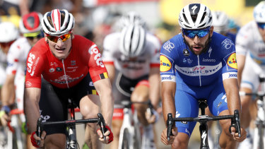 Colombia's Fernando Gaviria (right) crosses the finish line to win the fourth stage of the Tour de France.