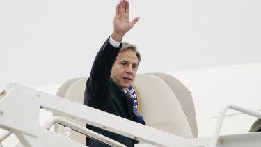 US Secretary of State Antony Blinken waves as he departs Andrews Air Force Base.