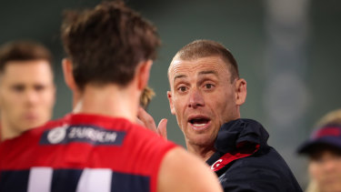 Dee-monstrative: Melbourne coach Simon Goodwin during Sunday night's 57-point win over the Kangaroos.