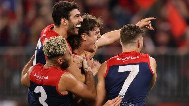 Christian Petracca, Christian Salem, and Jack Viney swarm young Demons ruckman Luke Jackson after a grand final goal.