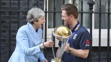 England captain Eoin Morgan shares a laugh with British PM Theresa May.
