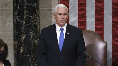 Vice-President Mike Pence reads the final certification of Electoral College votes on the night of the riots.