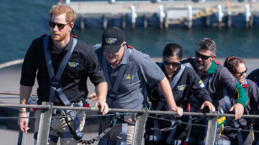 Prince Harry, Prime Minister Scott Morrison, and some Invictus Games competitors scale the Sydney Harbour Bridge.