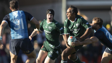 Still got it: Andrew Walker takes on the Pumas at Coogee Oval during a cameo for the 45-year-old.