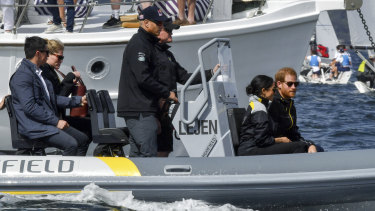 The Duke and Duchess of Sussex, Harry and Meghan, sail on Sydney Harbour on the first day of the Invictus Games in Sydney.