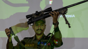 An Indian army officer displays a sniper gun recovered during a search operation along the Amarnath route, during a joint press conference in Srinagar, Indian-controlled Kashmir.