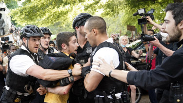 Uniformed US Secret Service police detain a protester in Lafayette Park across from the White House in the wake of George Floyd's death.