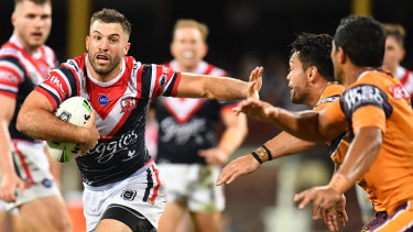 Brush-off: Roosters fullback James Tedesco turns on the afterburners against Brisbane.