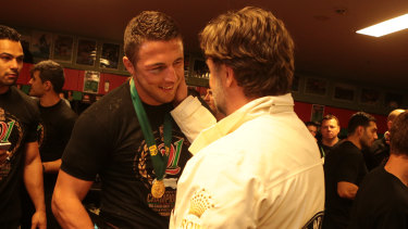 Sam Burgess talking with Russell Crowe after the Rabbitohs defeated the Bulldogs in the 2014 NRL grand final.
