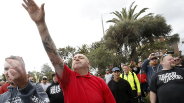 A protester issues a Nazi salute at rally in St Kilda.