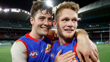 Josh Dunkley and Adam Treloar celebrate their preliminary final win over Port Adelaide.