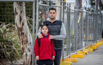 Alonso Chiok Diaz with his daughter Cielo Chiok-Medrano, 8. He says Cielo was playing in the garden beds at school the same day it was revealed asbestos had been found.