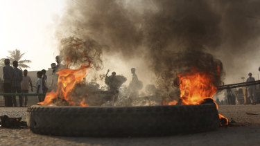 Pakistani protesters burn tyres while blocking a main road during a protest after a court decision to acquit the Christian of blasphemy charges.