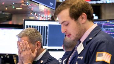 'Boom, we puke': Traders on the floor of the New York Stock Exchange.